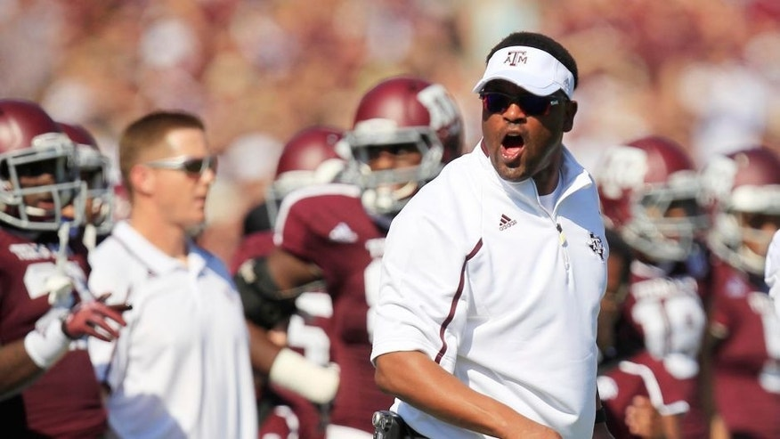 Oct 26, 2013; College Station, TX, USA; Texas A&M Aggies head coach Kevin Sumlin argues a call against the Vanderbilt Commodores during the first half at Kyle Field. Mandatory Credit: Thomas Campbell-USA TODAY Sports