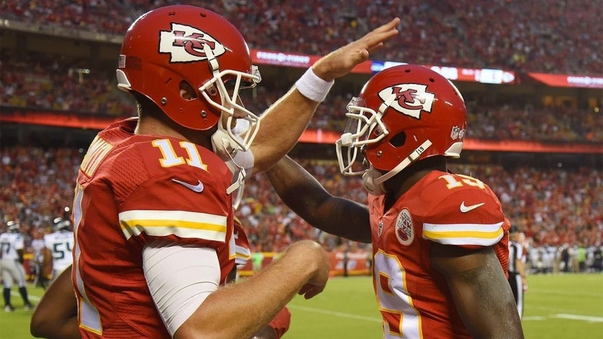 Aug 21, 2015; Kansas City, MO, USA; Kansas City Chiefs wide receiver Jeremy Maclin (19) celebrates with quarterback Alex Smith (11) after catching a touchdown pass against the Seattle Seahawks in the first half at Arrowhead Stadium. Mandatory Credit: John Rieger-USA TODAY Sports