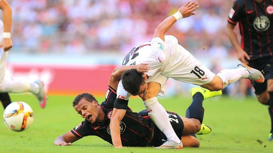 STUTTGART, GERMANY - AUGUST 29: Filip Kostic (R) of Stuttgart fights for the ball with Timothy Chandler (L) of Frankfurt during the Bundesliga match between VfB Stuttgart and Eintracht Frankfurt at Mercedes-Benz Arena on August 29, 2015 in Stuttgart, Germany. (Photo by Thomas Niedermueller/Bongarts/Getty Images)