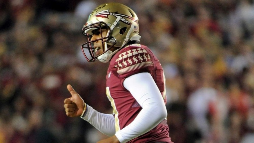 Oct 18, 2014; Tallahassee, FL, USA; Florida State Seminoles kicker Roberto Aguayo (19) gives a thumbs up to the sidelines after a kick during the game against the Notre Dame Fighting Irish at Doak Campbell Stadium. Mandatory Credit: Melina Vastola-USA TODAY Sports