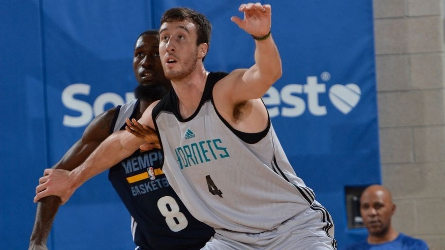 <p>ORLANDO, FL - JULY 5: Frank Kaminsky #4 of the Charlotte Hornets defends the ball against the Memphis Grizzlies during the game on July 5, 2015 at Amway Center in Orlando, Florida. NOTE TO USER: User expressly acknowledges and agrees that, by downloading and or using this photograph, User is consenting to the terms and conditions of the Getty Images License Agreement. Mandatory Copyright Notice: Copyright 2015 NBAE (Photo by Fernando Medina/NBAE via Getty Images)</p>