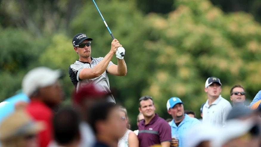 Henrik Stenson, of Sweden, tees off on the second hole during the final round of play at The Barclays golf tournament Sunday, Aug. 30, 2015, in Edison, N.J. (AP Photo/Adam Hunger)