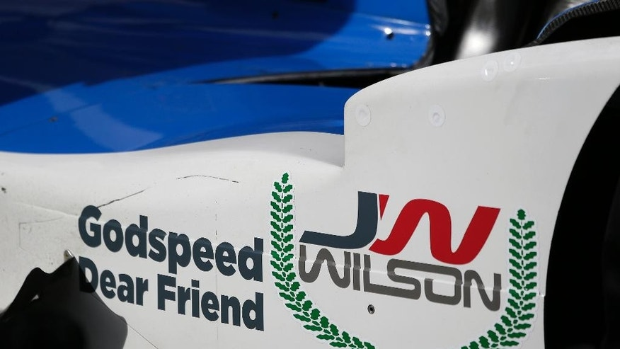 A tribute to Justin Wilson is displayed on the side of the No. 19 car driven by Tristan Vautier, of France, during practice for the IndyCar auto race Friday, Aug. 28, 2015, in Sonoma, Calif. Wilson, of England, died Monday from injuries sustained at Pocono Raceway on Sunday. (AP Photo/Eric Risberg)