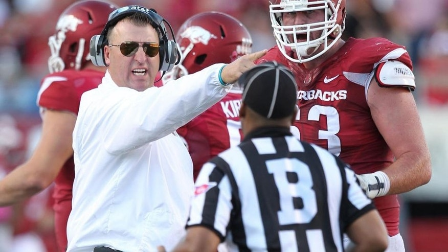 Oct 18, 2014; Little Rock, AR, USA; Arkansas Razorbacks head coach Bret Bielema and offensive tackle Dan Skipper (63) argue a call with an official during the game against the Georgia Bulldogs at War Memorial Stadium. Georgia defeated Arkansas 45-32. Mandatory Credit: Nelson Chenault-USA TODAY Sports