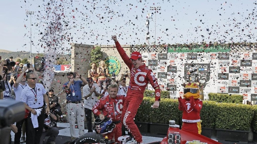 Scott Dixon, of New Zealand, celebrates atop his car after winning the IndyCar Grand Prix of Sonoma auto race and IndyCar championship Sunday, Aug. 30, 2015, in Sonoma, Calif. (AP Photo/Eric Risberg)