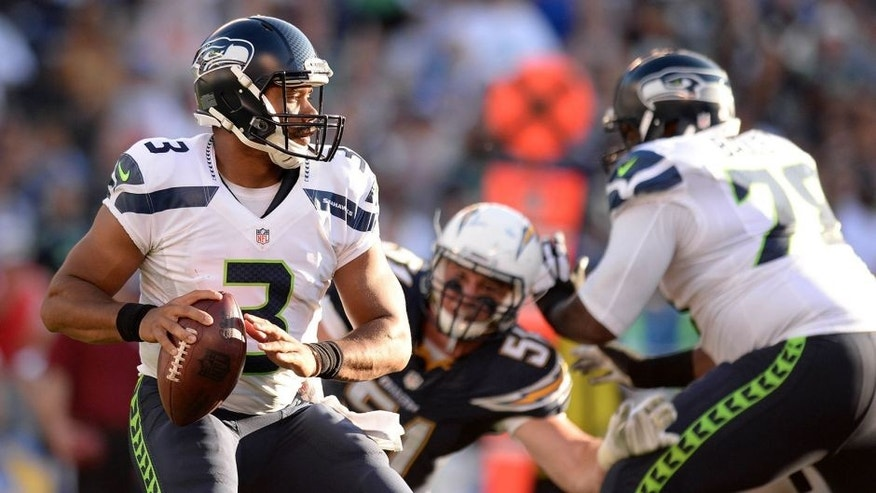 Aug 29, 2015; San Diego, CA, USA; Seattle Seahawks quarterback Russell Wilson (3) drops back to pass during the second quarter against the San Diego Chargers at Qualcomm Stadium. Mandatory Credit: Jake Roth-USA TODAY Sports