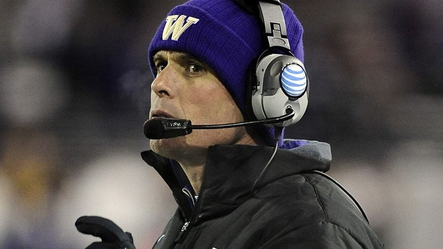 Nov 29, 2014; Pullman, WA, USA; Washington Huskies head coach Chris Petersen looks on against the Washington State Cougars during the second half at Martin Stadium. Huskies won 31-13. Mandatory Credit: James Snook-USA TODAY Sports