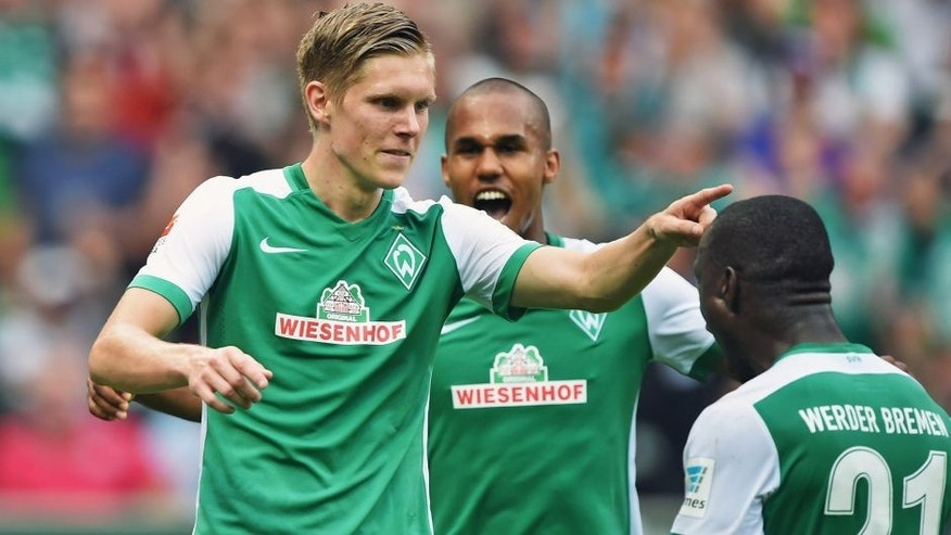 BREMEN, GERMANY - AUGUST 30: Aron Johansson of Bremen celebrates scoring his goal during the Bundesliga match between Werder Bremen and Borussia Moenchengladbach at Weserstadion on August 30, 2015 in Bremen, Germany. (Photo by Stuart Franklin/Bongarts/Getty Images)