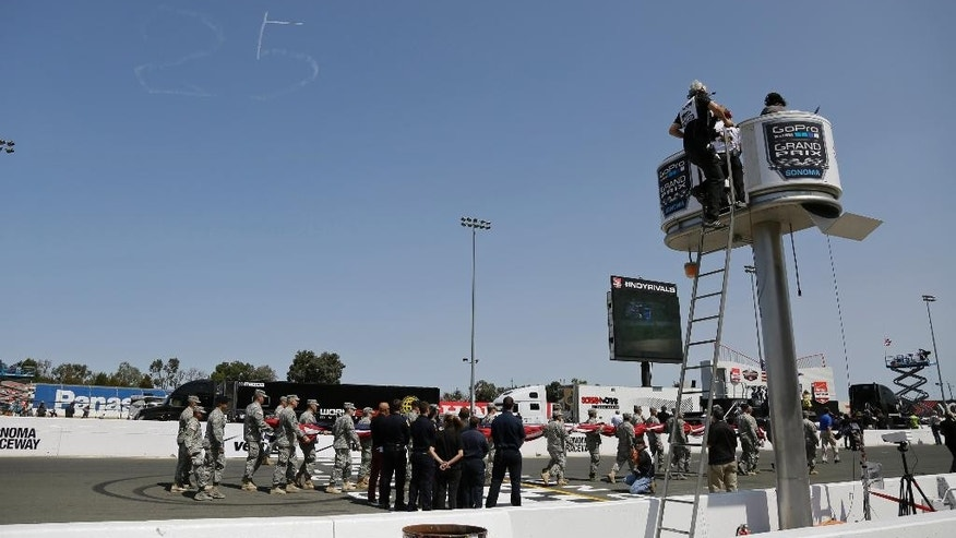 A skywriter makes a No. 25 in tribute to Justin Wilson before the IndyCar Grand Prix of Sonoma auto race Sunday, Aug. 30, 2015, in Sonoma, Calif. Wilson, of England, died Aug. 24 from injuries sustained at Pocono Raceway. (AP Photo/Eric Risberg)
