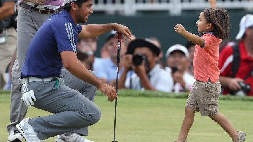 Jason Day, of Australia, is congratulated by his son Dash after winning The Barclays golf tournament Sunday, Aug. 30, 2015, in Edison, N.J. Day finished 19 under with a 261 total. (AP Photo/Adam Hunger)