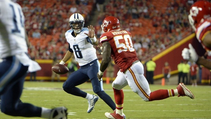 Aug 28, 2015; Kansas City, MO, USA; Tennessee Titans quarterback Marcus Mariota (8) is pressured by Kansas City Chiefs outside linebacker Justin Houston (50) in the first half at Arrowhead Stadium. Mandatory Credit: John Rieger-USA TODAY Sports