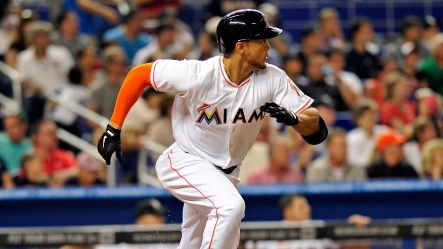 Apr 15, 2014; Miami, FL, USA; Miami Marlins right fielder Giancarlo Stanton connects for an RBI single during the fifth inning against the Washington Nationals at Marlins Ballpark. Mandatory Credit: Steve Mitchell-USA TODAY Sports