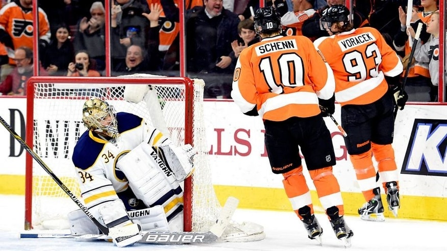 Feb 19, 2015; Philadelphia, PA, USA; Philadelphia Flyers right wing Jakub Voracek (93) celebrates his goal against Buffalo Sabres goalie Michal Neuvirth (34) during the second period at Wells Fargo Center. Mandatory Credit: Eric Hartline-USA TODAY Sports