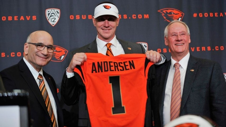 <p>Nov 15, 2014; Corvallis, OR, USA; Oregon State Beavers new football coach Gary Andersen (center) poses for a photo with athletic director Bob De Carolis (left) and president Edward Ray during a press conference at Reser Stadium. Mandatory Credit: Susan Ragan-USA TODAY Sports</p>