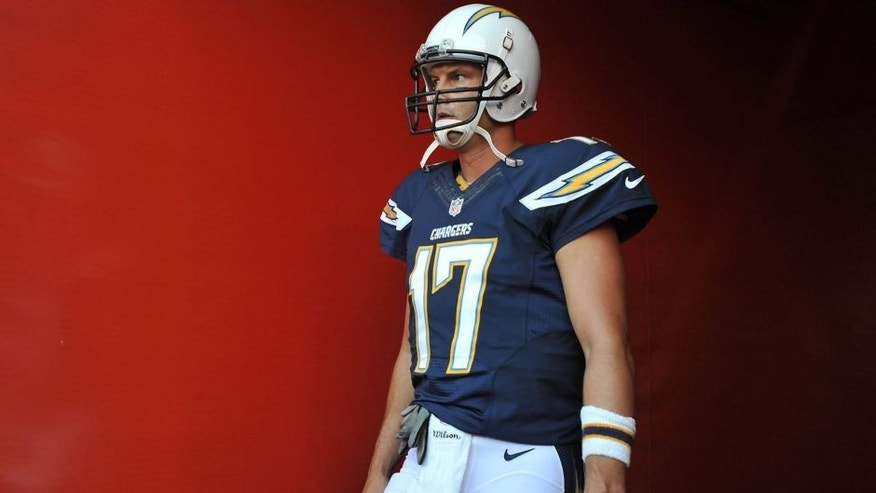 Aug 29, 2015; San Diego, CA, USA; San Diego Chargers quarterback Philip Rivers (17) heads towards the field before the preseason game against the Seattle Seahawks at Qualcomm Stadium. Mandatory Credit: Orlando Ramirez-USA TODAY Sports
