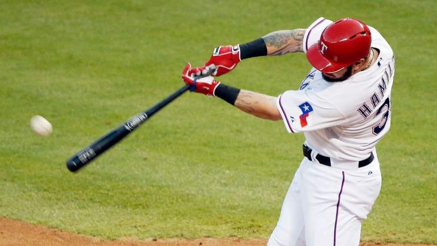 Texas Rangers Josh Hamilton makes contact for a solo home-run during the fourth inning of a baseball game against the Boston Red Sox, Friday, May 29, 2015, in Arlington, Texas. The home-run was Hamilton's second of the night. (AP Photo/Brandon Wade)