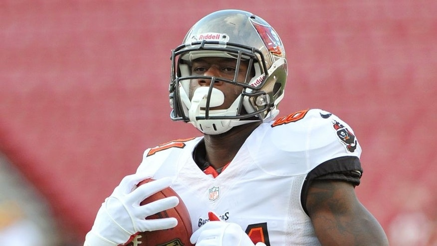 TAMPA, FL - AUGUST 29: Tight end Tim Wright #81 of the Tampa Bay Buccaneers warms up for play against the Washington Redskins August 29, 2013 at Raymond James Stadium in Tampa, Florida. (Photo by Al Messerschmidt/Getty Images)