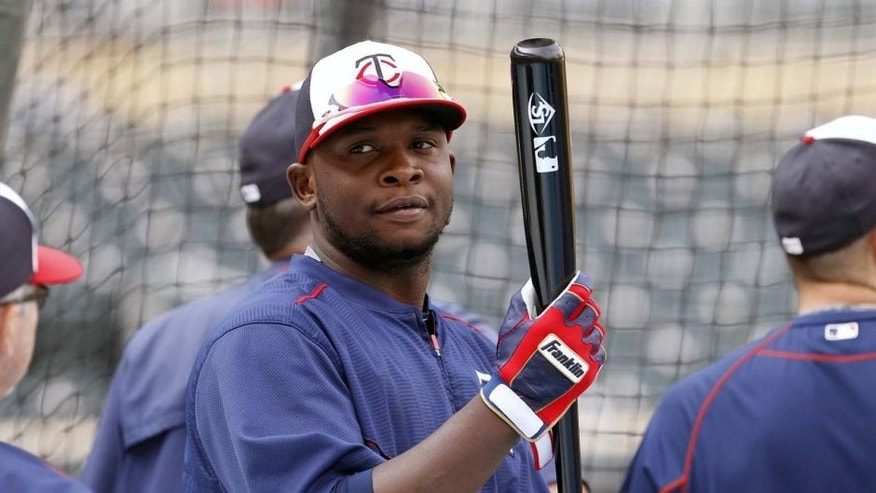 The Minnesota Twins' Miguel Sano waits to bat before a game against the Houston Astros in Minneapolis on Friday, Aug. 28, 2015.
