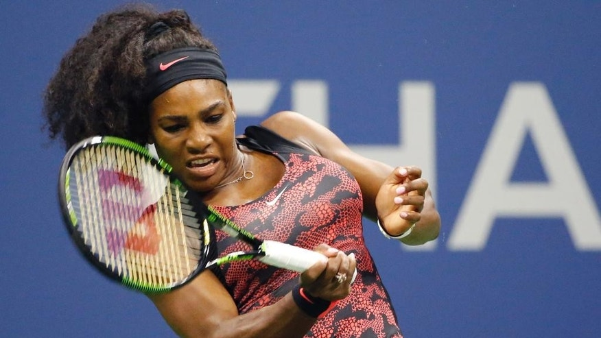 U.S. Open defending champion Serena Williams, of the United States, returns a ball during her first round match against Vitalia Diatchenko of Russia at the U.S. Open Tennis  tournament in New York, Monday, Aug. 31, 2015.  (AP Photo/Kathy Willens)