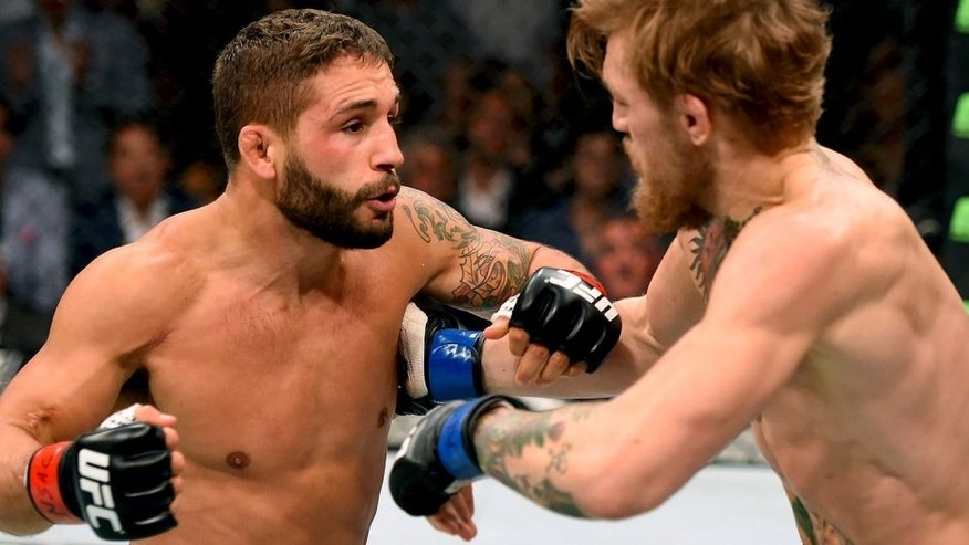 LAS VEGAS, NV - JULY 11: (L-R) Chad Mendes punches Conor McGregor in their UFC interim featherweight title fight during the UFC 189 event inside MGM Grand Garden Arena on July 11, 2015 in Las Vegas, Nevada. (Photo by Josh Hedges/Zuffa LLC/Zuffa LLC via Getty Images)