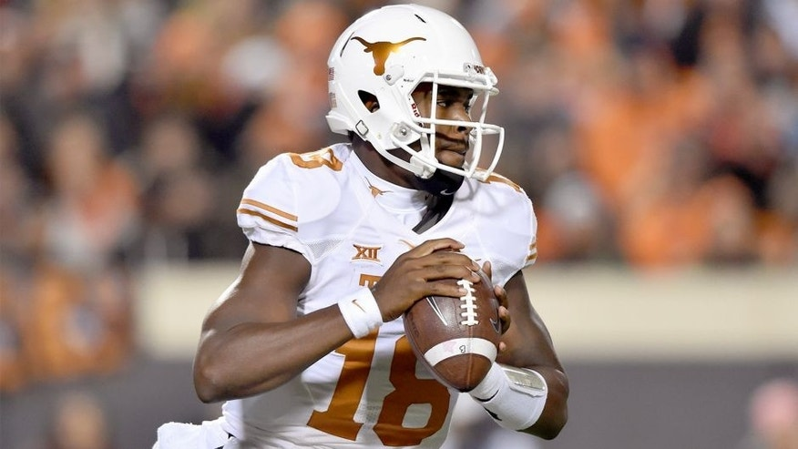 Nov 15, 2014; Stillwater, OK, USA; Texas Longhorns quarterback Tyrone Swoopes (18) looks down the field to pass against the Oklahoma State Cowboys during the first half at Boone Pickens Stadium. Mandatory Credit: Peter G. Aiken-USA TODAY Sports