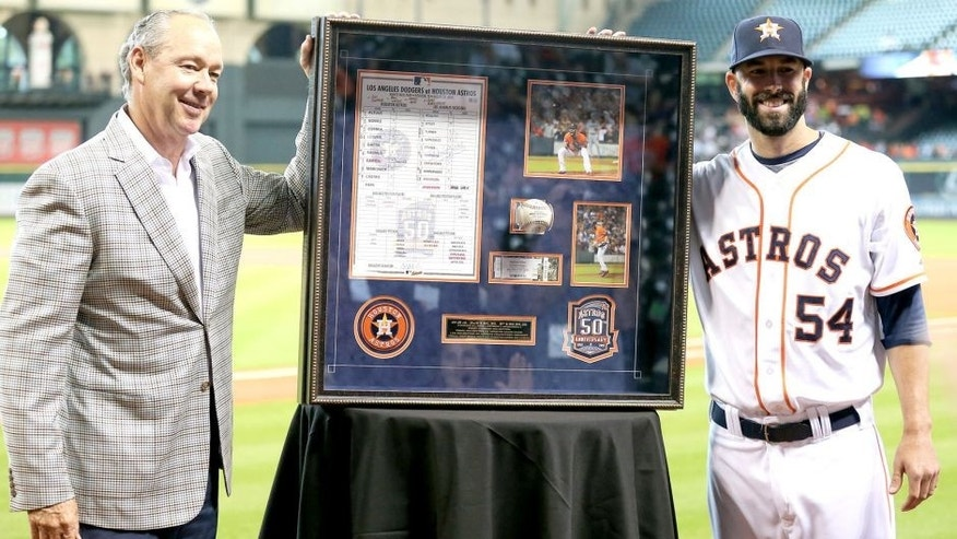 HOUSTON, TX - AUGUST 31: Mike Fiers #54 receives from Houston Astros owner Jim Crane a shadowbox of momentos from his no hitter on August 21, 2015 at Minute Maid Park on August 31, 2015 in Houston, Texas. (Photo by Bob Levey/Getty Images)