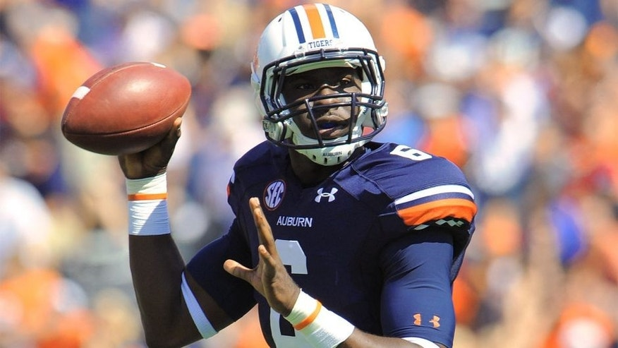Oct 12, 2013; Auburn, AL, USA; Auburn Tigers quarterback Jeremy Johnson (6) looks to pass during the first quarter against the Western Carolina Catamounts at Jordan Hare Stadium. Mandatory Credit: Shanna Lockwood-USA TODAY Sports