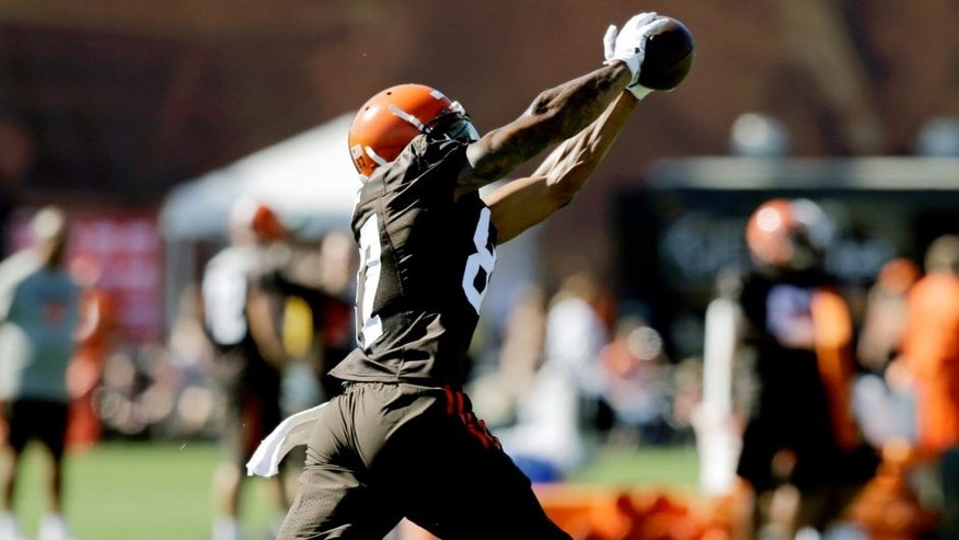 Cleveland Browns wide receiver Terrelle Pryor catches a pass during practice at the NFL football team's training camp Thursday, July 30, 2015, in Berea, Ohio. Pryor has been a quarterback his entire football life, but the gifted athlete is swtiching positions at the highest level, trying to win a roster spot as a wide receiver for the Cleveland Browns. He's impressive in pads, but the Browns need him to do more than look good in his uniform. (AP Photo/Tony Dejak)