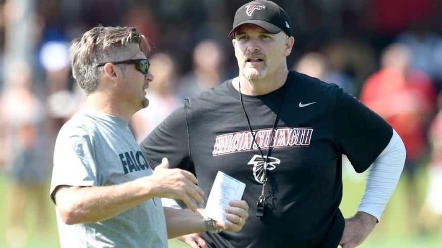 Jul 31, 2015; Flowery Branch, GA, USA; Atlanta Falcons head coach Dan Quinn (right) talks to General Manager Thomas Dimitroff on the field during training camp at Flowery Branch Training Facility. Mandatory Credit: Dale Zanine-USA TODAY Sports
