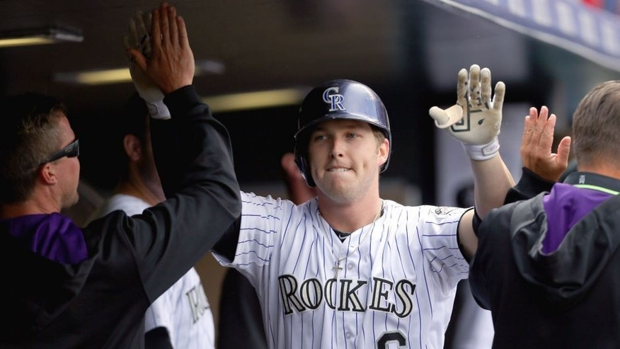 DENVER, CO - APRIL 23: Corey Dickerson #6 of the Colorado Rockies celebrates his solo home run during the fifth inning against the San Diego Padres at Coors Field on April 23, 2015 in Denver, Colorado. The Rockies defeated the Padres 2-1. (Photo by Justin Edmonds/Getty Images)