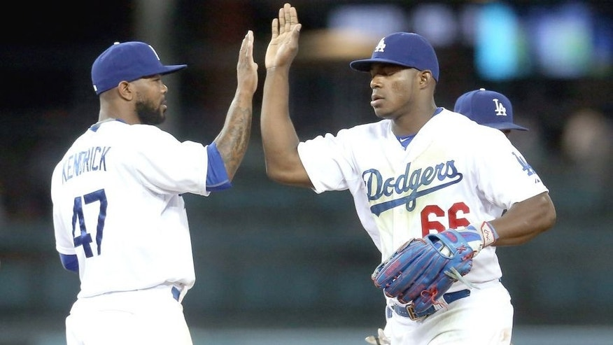 LOS ANGELES, CA - JULY 29: Yasiel Puig #66 and Howie Kendrick #47 of the Los Angeles Dodgers celebrate after the game against the Oakland Athletics at Dodger Stadium on July 29, 2015 in Los Angeles, California. The Dodgers won 10-7. (Photo by Stephen Dunn/Getty Images)