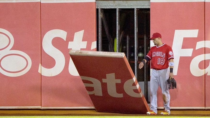OAKLAND, CA - AUGUST 31: Shane Victorino #18 of the Los Angeles Angels of Anaheim watches as a piece of the outfield wall falls onto the field during the fifth inning against the Oakland Athletics at O.co Coliseum on August 31, 2015 in Oakland, California. (Photo by Jason O. Watson/Getty Images)
