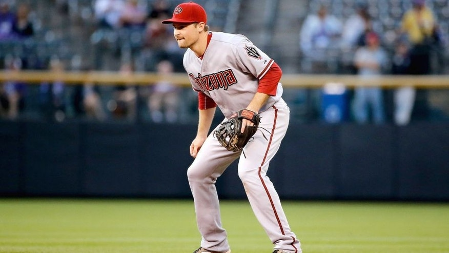 DENVER, CO - AUGUST 31: Second baseman Phil Gosselin #15 of the Arizona Diamondbacks plays defense against the Colorado Rockies at Coors Field on August 31, 2015 in Denver, Colorado. The Rockies defeated the Diamondbacks 5-4. (Photo by Doug Pensinger/Getty Images)
