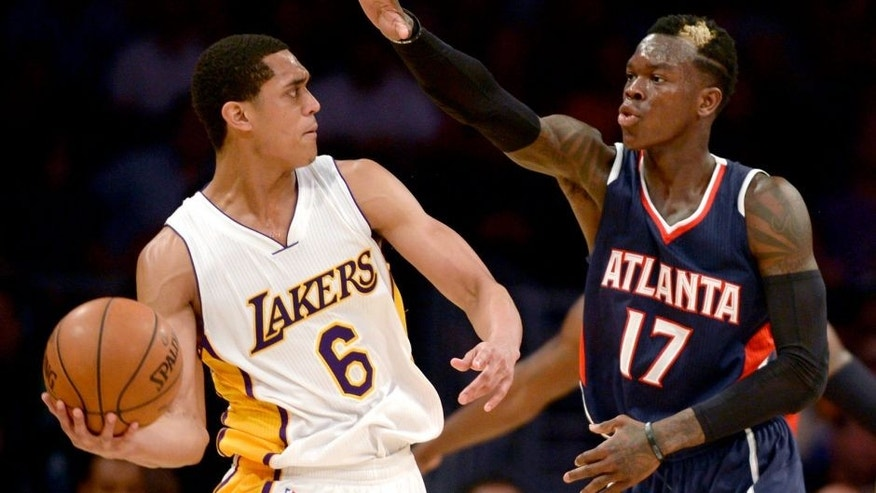 Mar 15, 2015; Los Angeles, CA, USA; Los Angeles Lakers guard Jordan Clarkson (6) looks to pass the ball defended by Atlanta Hawks guard Dennis Schroder (17) during the fourth quarter at Staples Center. The Atlanta Hawks won 91-86. Mandatory Credit: Kelvin Kuo-USA TODAY Sports