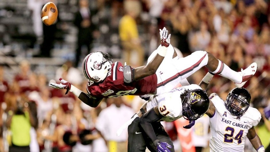 Sep 6, 2014; Columbia, SC, USA; South Carolina Gamecocks tight end Jerell Adams (89) is upended going for the reception by East Carolina Pirates defensive back Domonique Lennon (31) during game action between the South Carolina Gamecocks and East Carolina Pirates at Williams-Brice Stadium. Mandatory Credit: Jim Dedmon-USA TODAY Sports