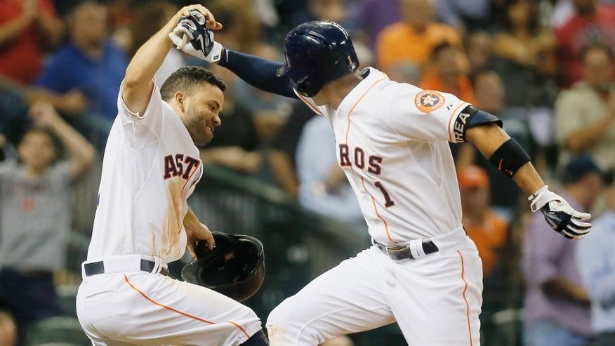 HOUSTON, TX - AUGUST 31: Carlos Correa #1 of the Houston Astros is congratulated by Jose Altuve #27 after hitting a home run in the fifth inning against the Seattle Mariners at Minute Maid Park on August 31, 2015 in Houston, Texas. (Photo by Bob Levey/Getty Images)