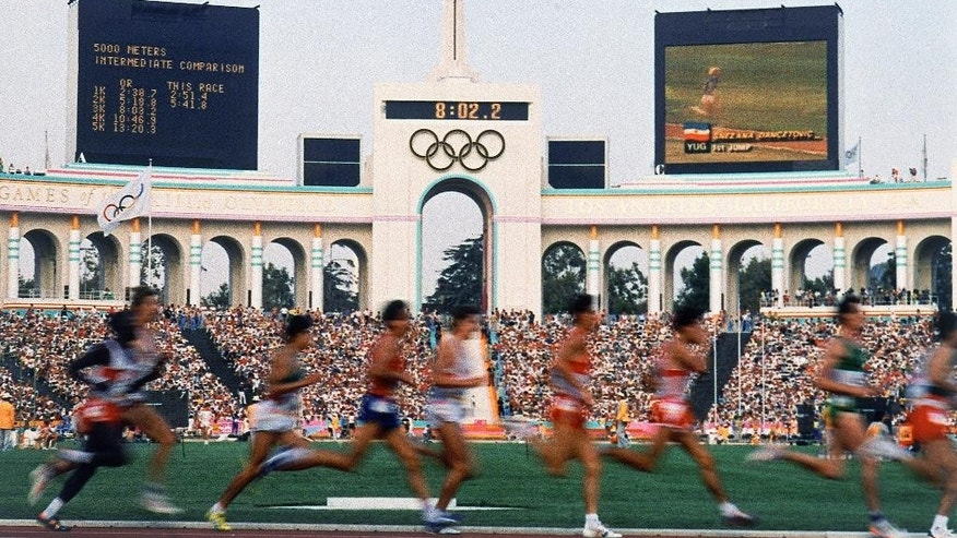 FILE - In this Aug. 1984 file photo, competitors run in the men's 5,000 meters at the Olympic Games in Los Angeles. (AP Photo/File)