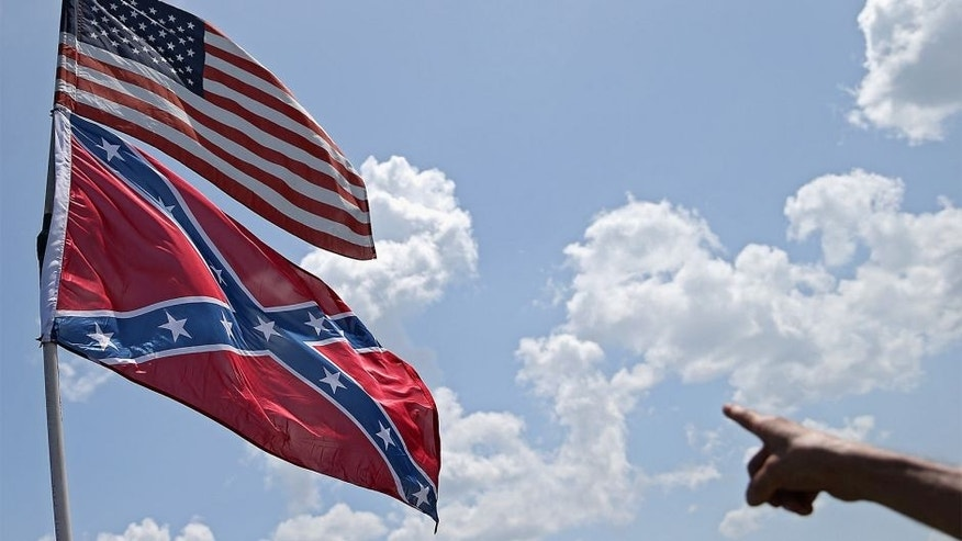 DAYTONA BEACH, FL - JULY 03: An American and a Confederate flag are seen during practice for the NASCAR Sprint Cup Series Coke Zero 400 at Daytona International Speedway on July 3, 2015 in Daytona Beach, Florida. (Photo by Patrick Smith/Getty Images)