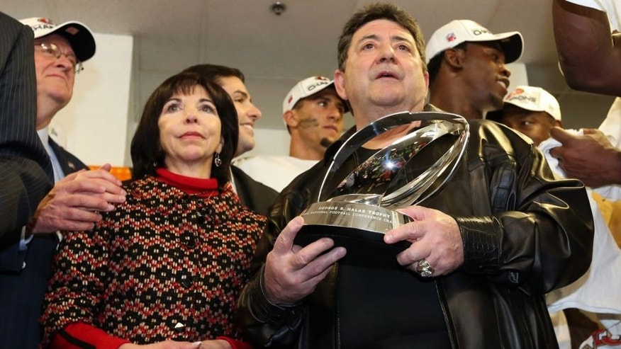 Jan 20, 2013; Atlanta, GA, USA; San Francisco 49ers former owner Eddie DeBartolo (right) and co-chair Denise DeBartolo York (left) present the trophy for the NFC Championship game against the Atlanta Falcons at the Georgia Dome. The 49ers won 28-24. Mandatory Credit: Matthew Emmons-USA TODAY Sports