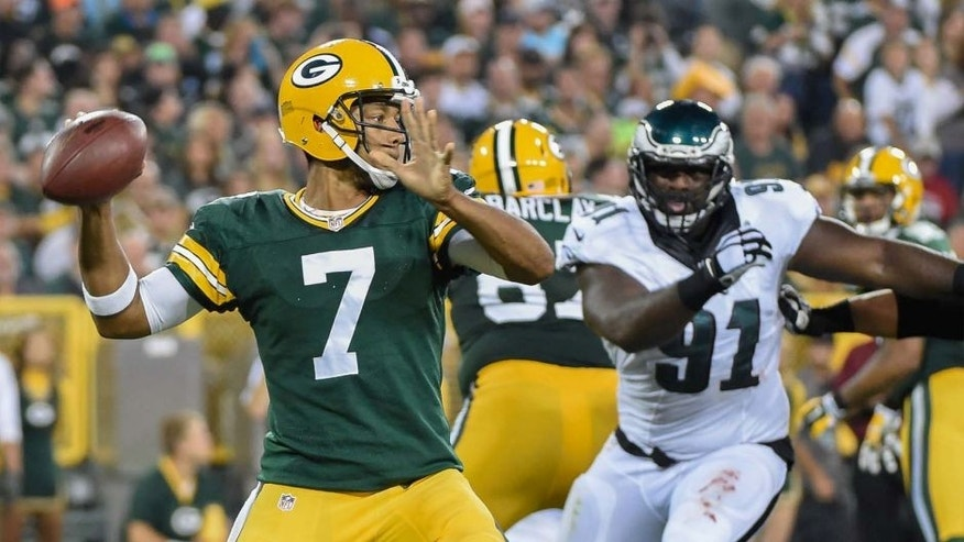 Green Bay Packers quarterback Brett Hundley gets a pass away while under pressure from Philadelphia Eagles defensive end Fletcher Cox in the second quarter of a preseason game at Lambeau Field on Saturday, Aug. 29, 2015.