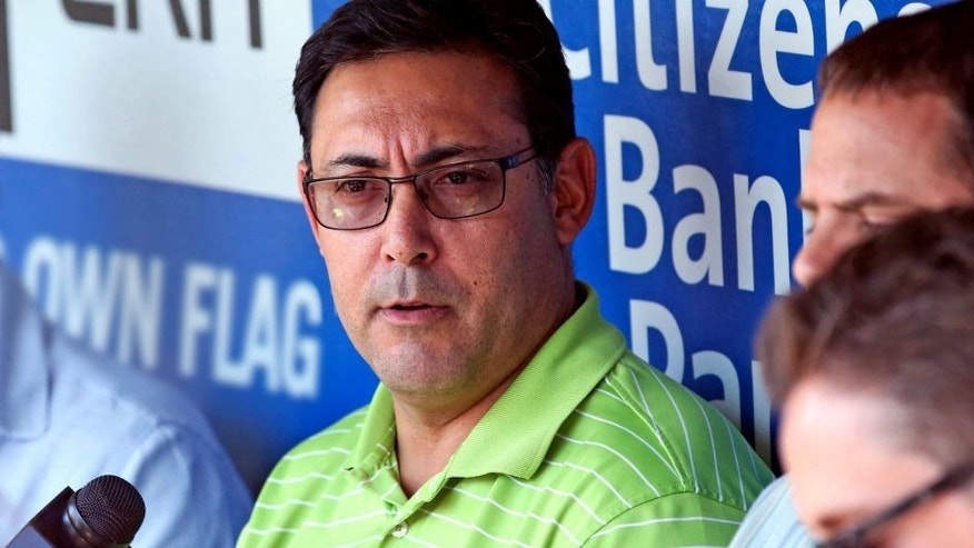 Jul 25, 2014; Philadelphia, PA, USA; Philadelphia Phillies general manager Ruben Amaro, Jr. talks with reporters during batting practice before a game against the Arizona Diamondbacks at Citizens Bank Park. Mandatory Credit: Bill Streicher-USA TODAY Sports