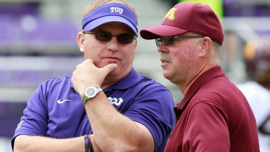 <p>Sep 13, 2014; Fort Worth, TX, USA; TCU Horned Frogs head coach Gary Patterson (L) talks with Minnesota Golden Gophers head coach Jerry Kill (R) prior to their game at Amon G. Carter Stadium. Mandatory Credit: Tim Heitman-USA TODAY Sports</p>