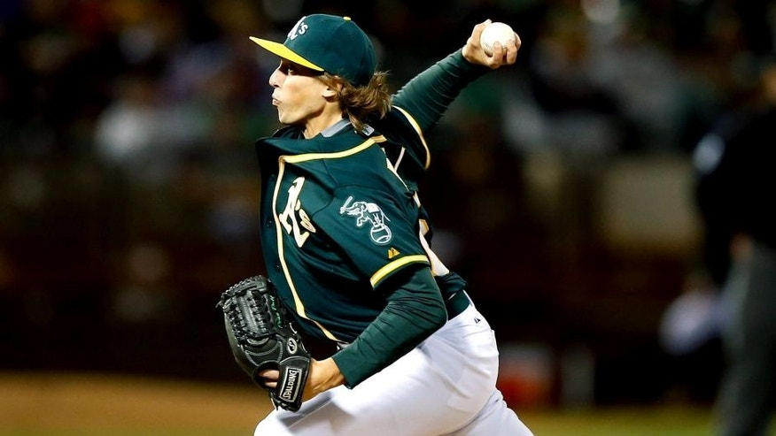 OAKLAND, CA - SEPTEMBER 01: Ryan Dull #66 of the Oakland Athletics pitches against the Los Angeles Angels of Anaheim in the eighth inning at O.co Coliseum on September 1, 2015 in Oakland, California. This was his Major League debut. (Photo by Ezra Shaw/Getty Images)