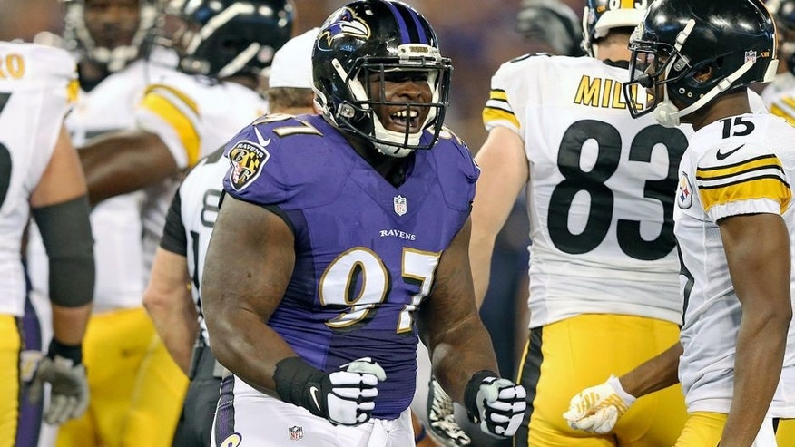 Sep 11, 2014; Baltimore, MD, USA; Baltimore Ravens tackle Timmy Jernigan (97) reacts following his tackle against the Pittsburgh Steelers at M&T Bank Stadium. Mandatory Credit: Mitch Stringer-USA TODAY Sports