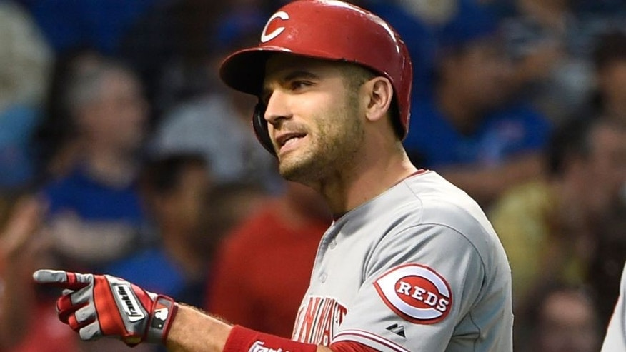 Jun 13, 2015; Chicago, IL, USA; Cincinnati Reds first baseman Joey Votto (19) reacts as he crosses home plate after hitting a home run against the Chicago Cubs during the fourth inning at Wrigley Field. Mandatory Credit: David Banks-USA TODAY Sports
