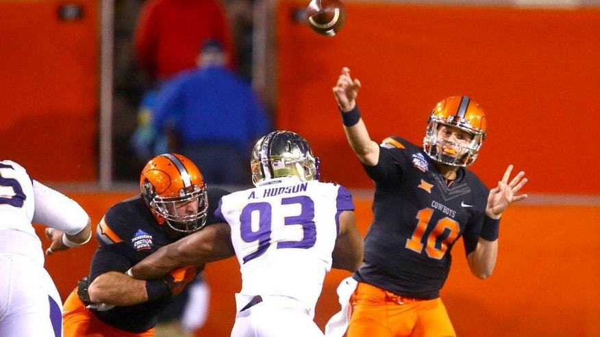 Jan 2, 2015; Tempe, AZ, USA; Oklahoma State Cowboys quarterback Mason Rudolph (10) throws a pass in the first quarter against the Washington Huskies in the 2015 Cactus Bowl at Sun Devil Stadium. Mandatory Credit: Mark J. Rebilas-USA TODAY Sports
