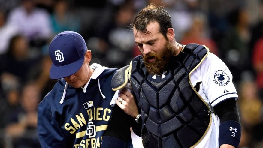 SAN DIEGO, CA - SEPTEMBER 1: Derek Norris #3 of the San Diego Padres, right, comes out of the game with a trainer during the seventh inning of a baseball game against the Texas Rangers at Petco Park September, 1, 2015 in San Diego, California. (Photo by Denis Poroy/Getty Images)