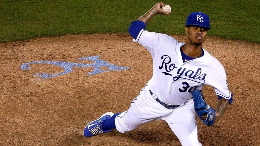 Kansas City Royals starting pitcher Yordano Ventura throws during the sixth inning of a baseball game against the Detroit Tigers on Wednesday, Sept. 2, 2015, in Kansas City, Mo. (AP Photo/Charlie Riedel)