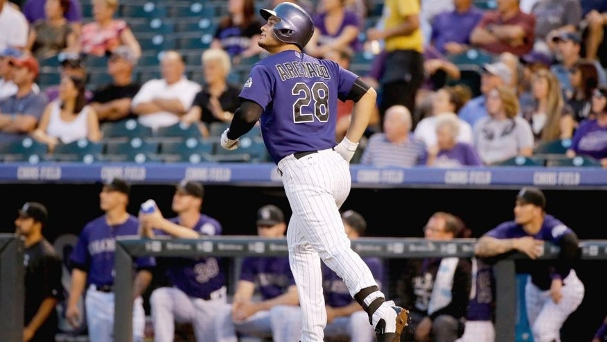 DENVER, CO - SEPTEMBER 02: Nolan Arenado #28 of the Colorado Rockies watches his two run home run off of Chase Anderson #57 of the Arizona Diamondbacks to give the Rockies a 3-1 lead in the first inning at Coors Field on September 2, 2015 in Denver, Colorado. (Photo by Doug Pensinger/Getty Images)