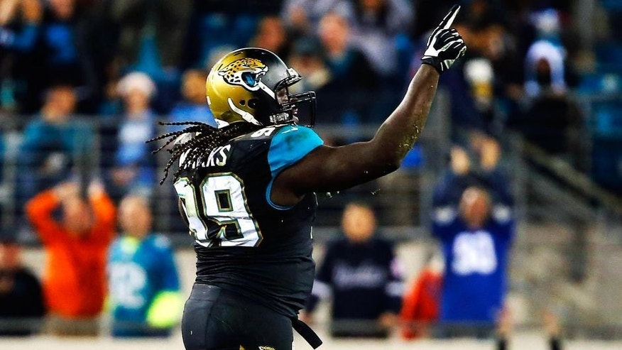 JACKSONVILLE, FL - DECEMBER 18: Sen'Derrick Marks #99 of the Jacksonville Jaguars celebrates a sack in the fourth quarter against the Tennessee Titans at EverBank Field on December 18, 2014 in Jacksonville, Florida. (Photo by Sam Greenwood/Getty Images)